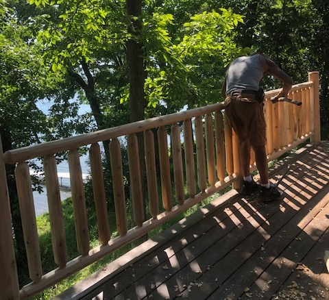 Metal railing on log home