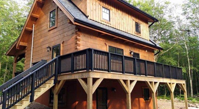 Metal railing on a log home